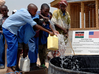 Children getting clean Drinking water from a well built by the Naval Mobile Construction Battalion in Kenya.
