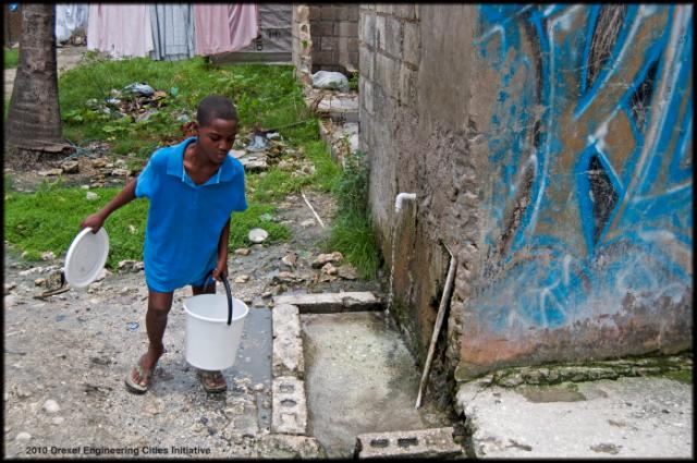 A Haitian boy fetches water in Leogane, the epicenter of the Jan. 12 earthquake. Photo courtesy Jennifer Britton/Drexel Engineering Cities Initiative