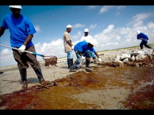 A cleanup crew paid by BP working to remove oil from a beach on Elmer Island, Louisiana, last month.
