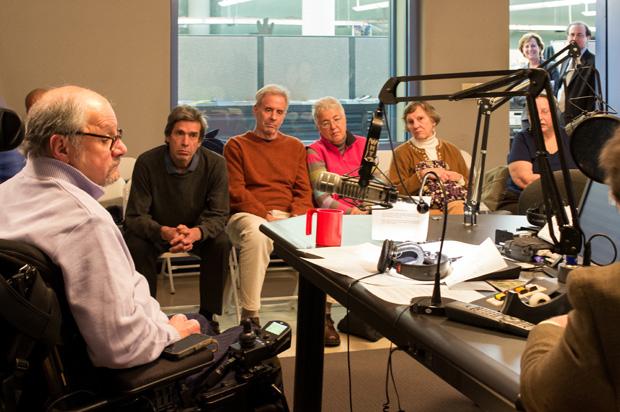 Dr. Dan Gottlieb (left) sits with live studio audience