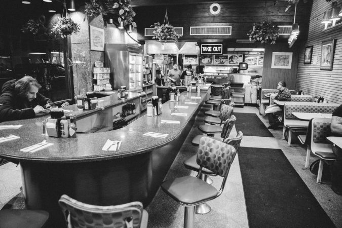 The late night scene on a Monday at Little Pete's. (Neal Santos/WHYY)