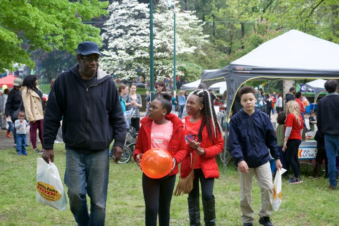 "East Mt Airy resident Stephen ""Woowoo"" Woolson strolls over the grounds at Mt Airy Day, with him second to the right, is his niece Abriah Clark. (Bastiaan Slabbers for WHYY)"