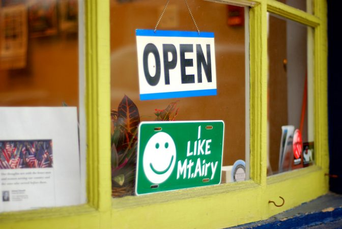In this 2012, file photo a 'I like Mt Airy' sign sits behind a store front in the main retail district of Mt Airy on Germantown Avenue. (Bastiaan Slabbers for WHYY)