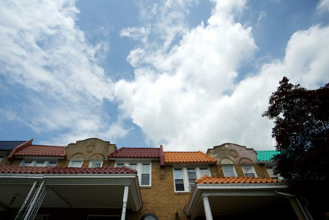 The roofs of these homes on Mower Street, in West Mt Airy are decorated in various colors. (Bastiaan Slabbers for WHYY)