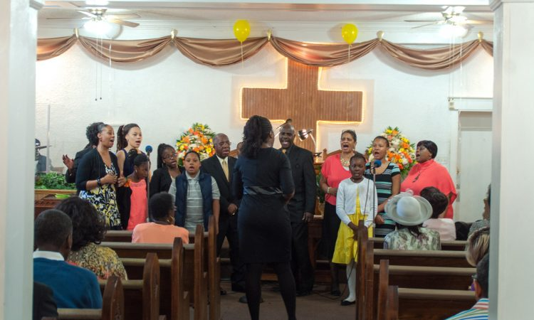 The church choir leads the congregation in song.
