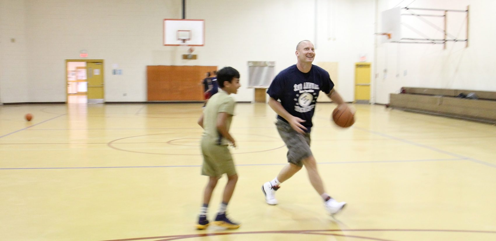 Anthony Famiglietti, coaching basketball at East Passyunk Community Rec Center.  (Emma Lee/WHYY)