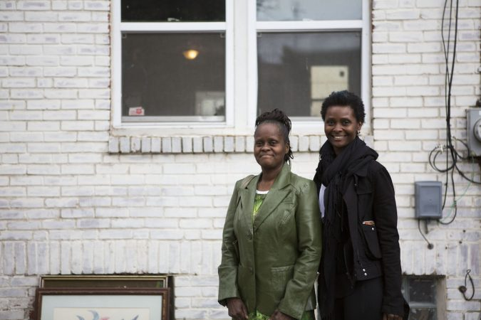 Diane Precht, right, and her mother Daisy Baptiste, right, in front of their former home on Williams Street in Jewtown. (Photo by Jessica Kourkounis)