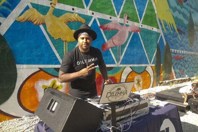 DJ Dilemma provides the soundtrack at the Storytelling Block Party. (Miguel Martinez/Every ZIP Philadelphia)