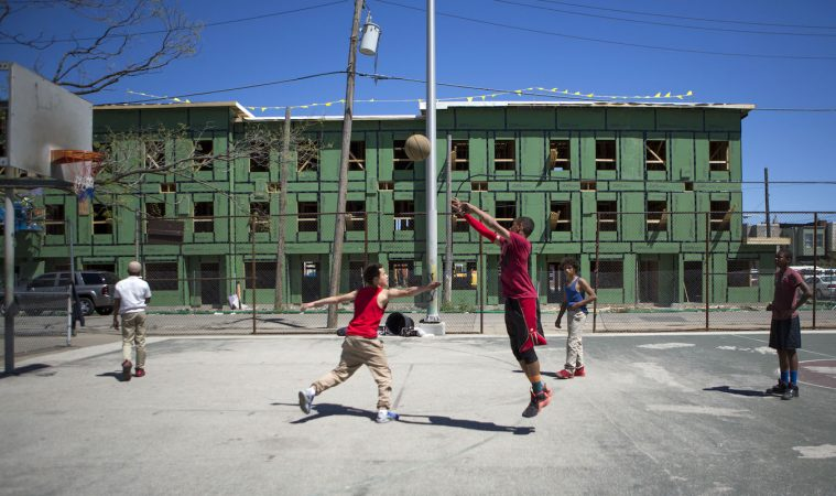 Neighborhood kids play basketball at Jewtown Park. Across from the park is a new development of low income housing. The development is receiving mixed views from residents both past and present. The kids say they do not like the neighborhood because there are a lot of drugs and violence. (Photo by Jessica Kourkounis)
