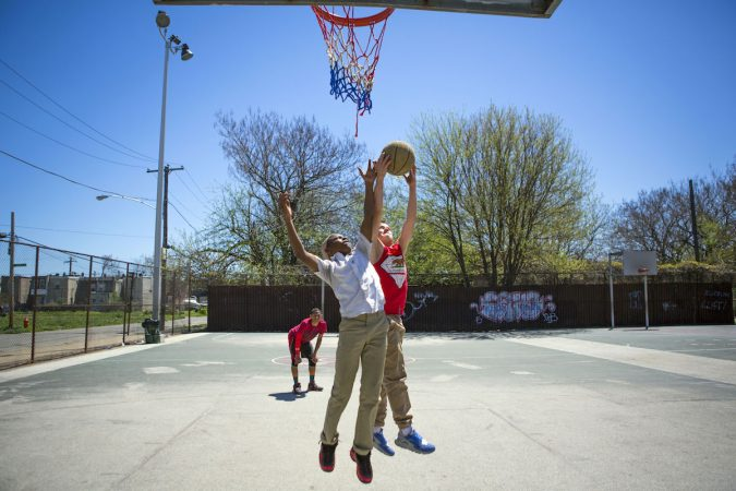 Neighborhood kids play basketball at Jewtown Park. The kids say they do not like the neighborhood because there are a lot of drugs and violence. (Photo by Jessica Kourkounis)