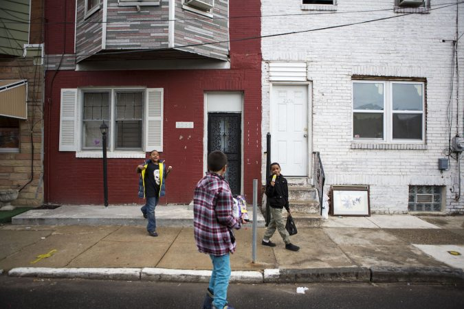 Neighborhood kids play on East Williams Street near Tulip Street in Jewtown. The white house is the former home of Diane Precht and her family. (Photo by Jessica Kourkounis)