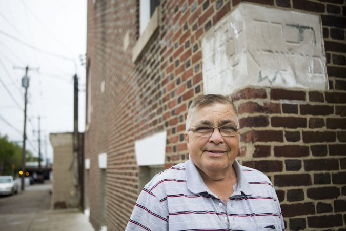 Historian and author Allen Meyers stands outside what was originally one of two synagogues located in Jewtown. There is still a cornerstone visible with Hebrew writing in what is now Disney ABA church at the corner of Tulip and Auburn Streets. Meyers co-authored the book The Jewish Community Under the Frankford El, which included a history of Jewtown and a collection of archival photographs. (Photo by Jessica Kourkounis)