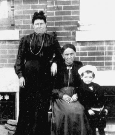 Family portraits were taken in front of homes throughout Jewtown on a regular basis. The wife of Rabbi Brenner, left, commanded the respect of the entire community, without people uttering her first name. She was affectionately addressed as rebbetzen, Yidish for