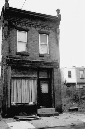The last relics of a bygone era can be found in Newtown near Williams and Tulip Street, where Jewish life once abounded. People flocked to Friedman Shoes inside a private residence converted by a storefront facade. (Courtesy of Carl Nathans)