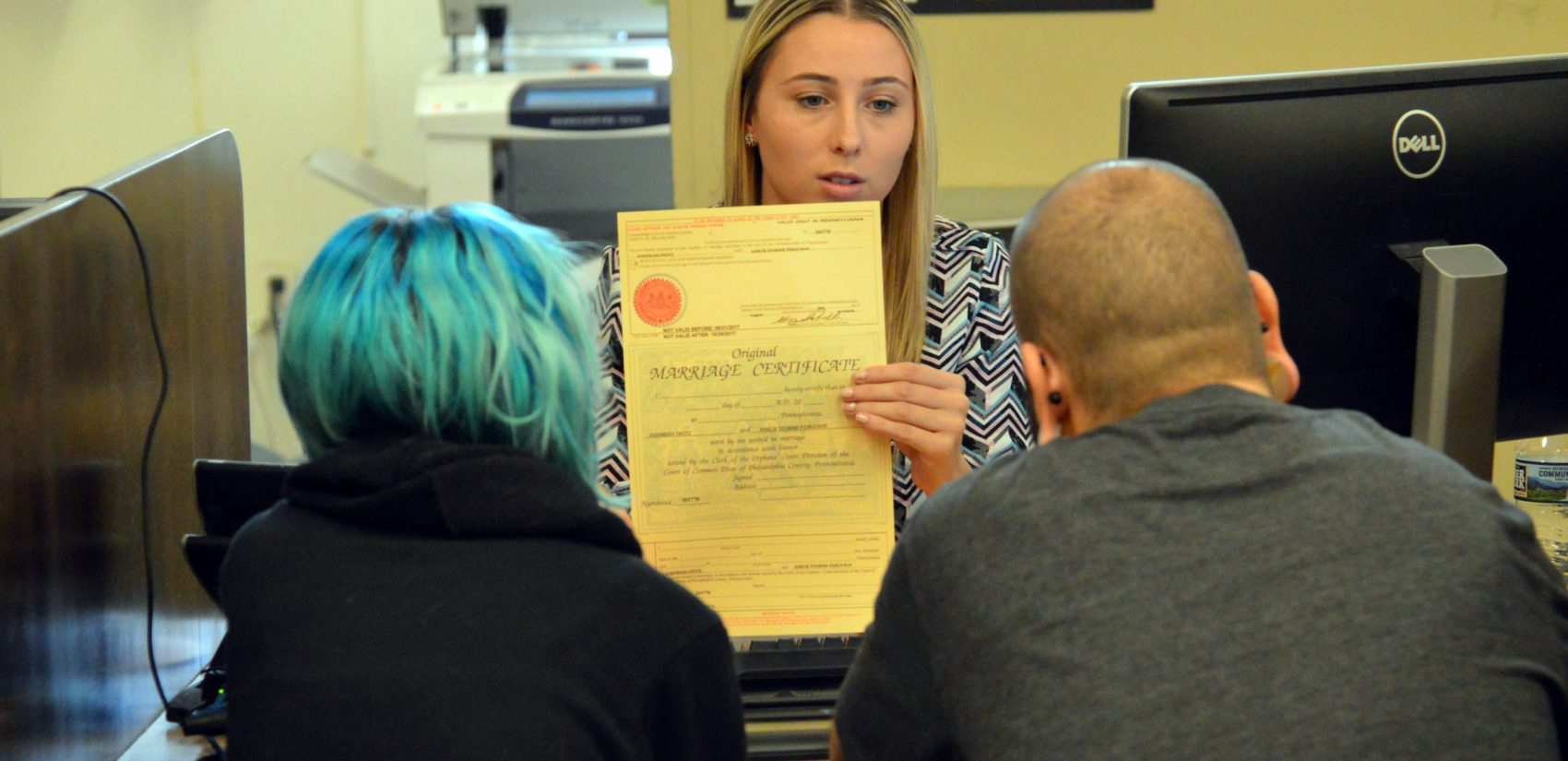 Lindsey Keenan talks marriage licenses with Ashley Ferguson and JohnRoss Switz. (Tom MacDonald/WHYY)