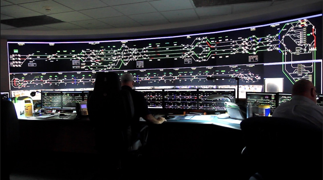 In SEPTA's control room, monitors keep tabs on bus and train routes, platforms. (Kimberly Paynter/WHYY)