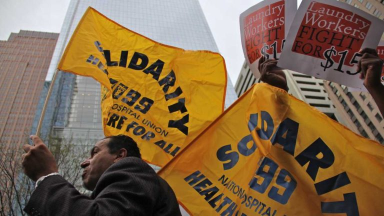 Protesters march through Center City demanding a $15 minimum wage.