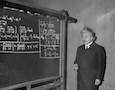 Albert Einstein at a chalkboard