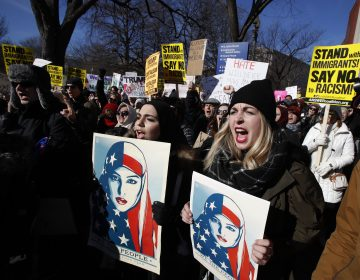 Martha Obermiller of Denver, right, chants during a rally protesting the immigration policies of President Donald Trump, near the White House in Washington, Saturday, Feb. 4, 2017.