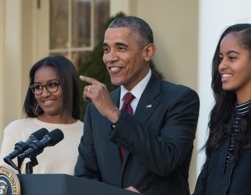 President Barack Obama with daughters Sasha (left) after Malia at his side, after