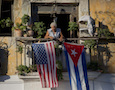 Cuban and American flags on a balcony