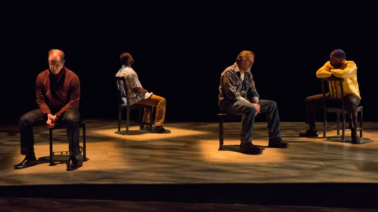"""Anthony Lawton, Akeem Davis, William Zielinski, and David Alan Anderson in """"The Exonerated,"""" onstage at Delaware Theatre Company through March 9. (Photo courtesy of Delaware Theatre Company)"""