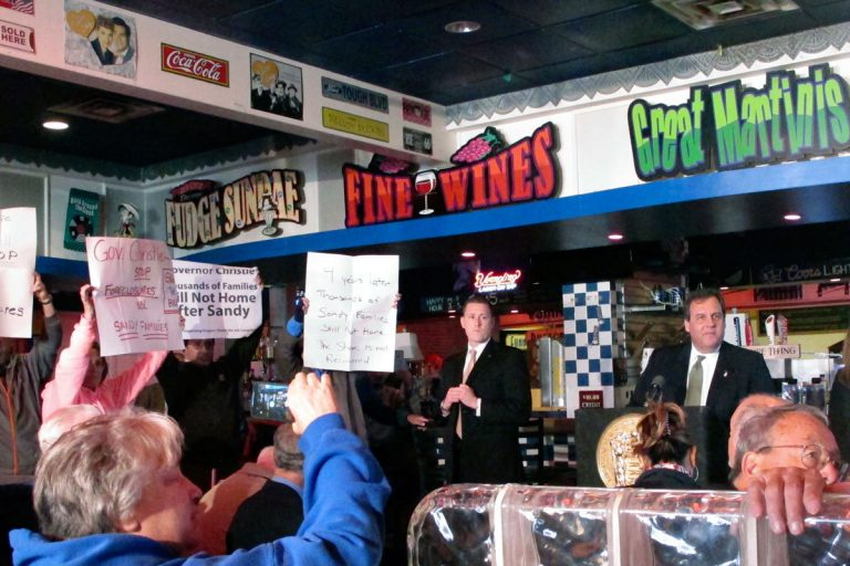 Gov. Christie (back right) looks away from protesters in Seaside Heights