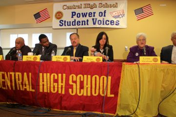 Mayoral candidates (from left) Jim Kenney, Milton Street, Doug Oliver, Nelson Diaz, Melissa Murray Bailey, Lynne Abraham and Anthony Williams participate in a forum at Central High School. (Emma Lee/WHYY)