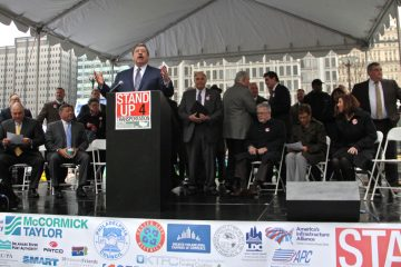 Government officials, politicians and labor leaders gather for a rally at Dilworth Park to demand federal funding for transportation infrastructure improvements. (Emma Lee/WHYY)