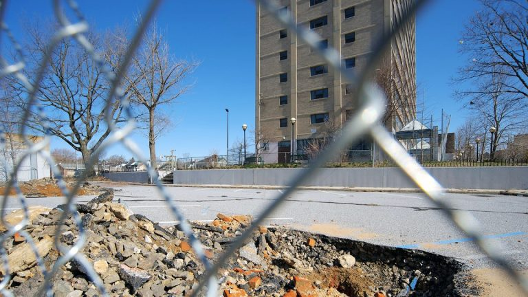 Bricks and debris are visible at one of the Potter's Field excavation sites behind the long-shuttered Queen Lane Apartments tower. (Bas Slabbers/for NewsWorks, file)