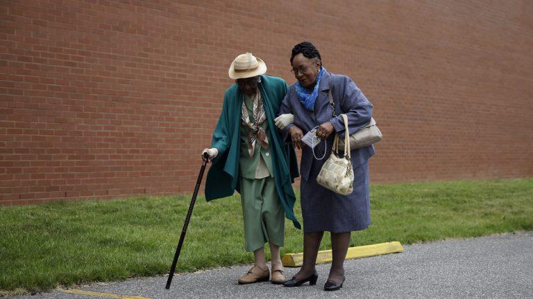Gloria Jamison, right, escorts her mother, Isabella Jamison, who was born on Feb. 14, 1914, to Philadelphia's 15th Annual Centenarian Celebration at a union hall on Thursday, May 21, 2015, in Philadelphia. (AP Photo/Matt Slocum)