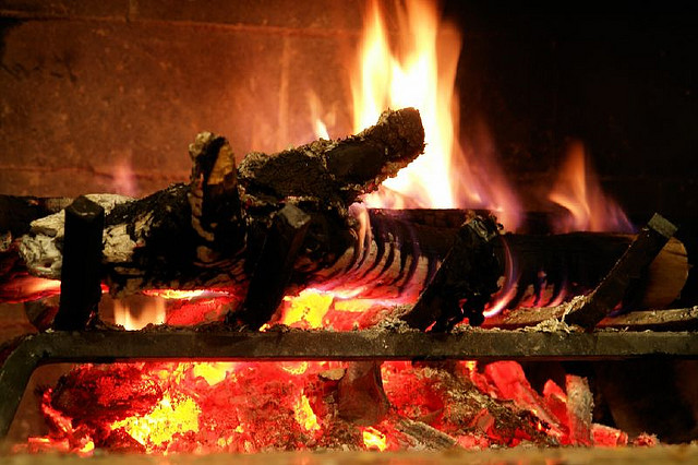 A warm, crackling fireplace in action. (Image: digitalshay via Flickr)