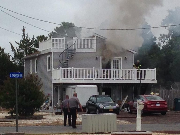 Smoke billowing from a house at 1 South Trenton Avenue in the Mystic Island section of Little Egg Harbor early Thursday afternoon. (Photo: JSHN contributor Rob Libonati)