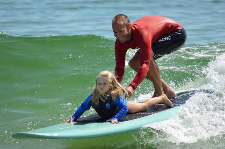 Riding a wave at the Waves of Impact surf camp in Lavallette on August 15, 2013. (Photo: Waves of Impact)
