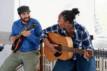 Adam Monaco and Danie Ocean, the Co-Executive Directors of Working While Playing in a Blue-grass jam session. (Bastiaan Slabbers/for NewsWorks)
