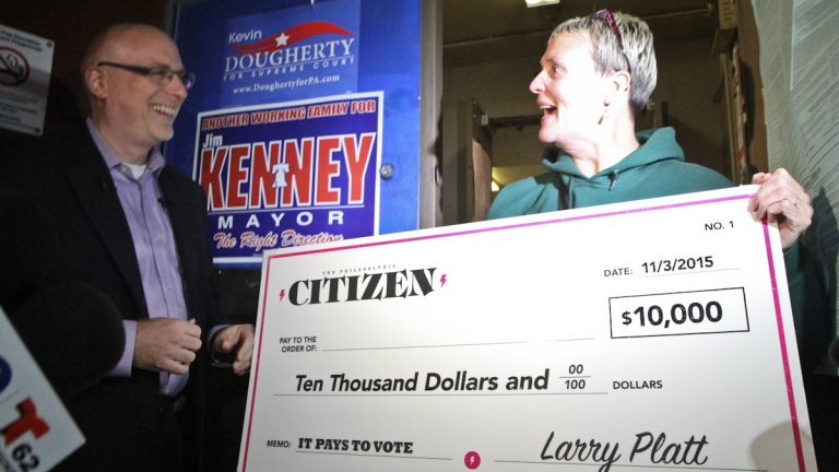 10th and Bigler crossing guard Bridget Conroy-Varnis irecieves 10K after voting.(Kimberly Paynter/WHYY)