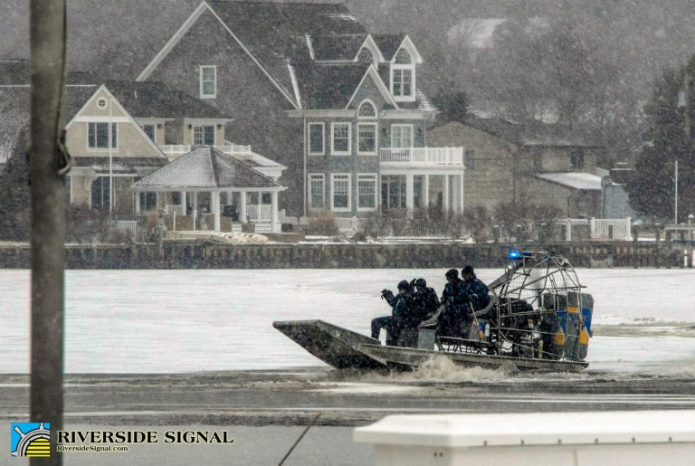 Marine crews search the frozen Toms River on March 1 after submerged pickup truck was discovered. (Image courtesy of Riverside Signal)