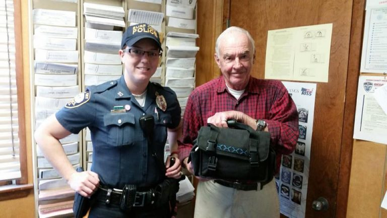 Ptlw. Sarah Collins and Ray McCarthy at Surf City Police Department headquarters today. (Photo courtesy of the Surf City Police Department)