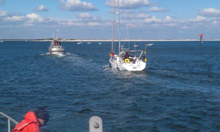 A Coast Guard vessel approaching the Barnegat Inlet today with a 42-foot disabled sailboat in tow. (Photo courtesy of the U.S. Coast Guard Station Barnegat Light)
