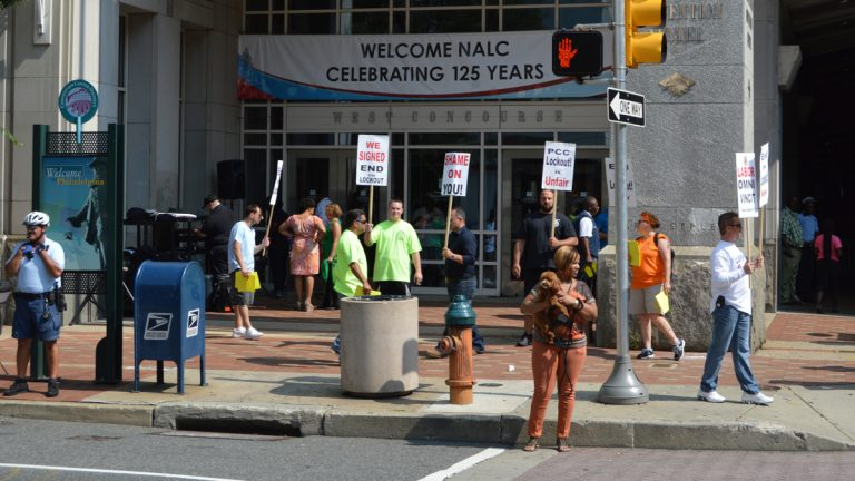 Members of the carpenters union protest outside the Pennsylvania Convention Center Monday. Postal workers are  having their annual meeting there. (Tom MacDonald/WHYY)