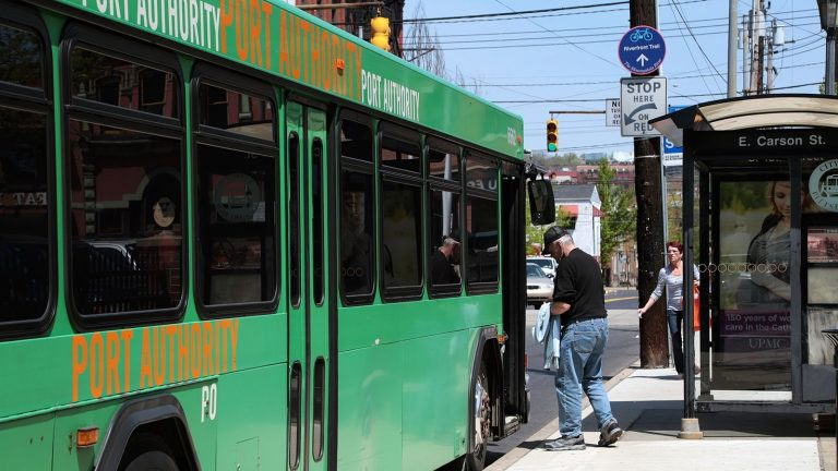A passenger boards a Port Authority of Allegheny County bus in Pittsburgh. (Ryan Loew/WESA)