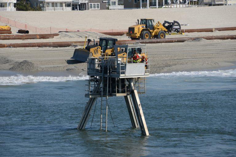 A Coastal Research Amphibious Buggy (CRAB) surveys the surf area of Brant Beach