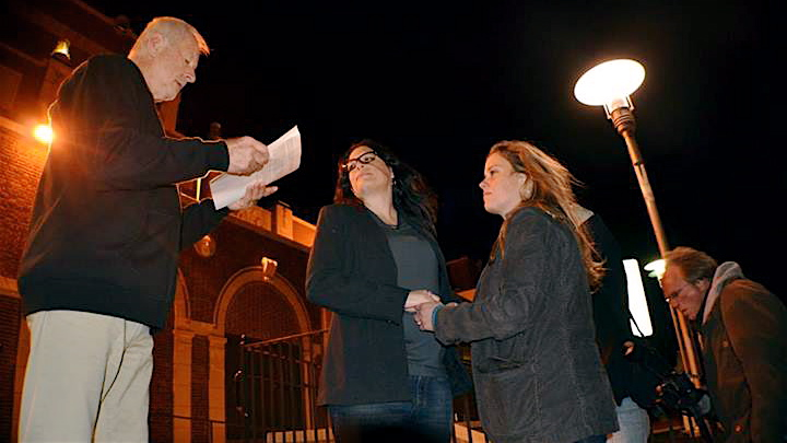 In Asbury Park early Monday, Tom Pivinski (left) officiated the marriage of Heather Jensen (center) and Amy Quinn (right). (Photo courtesy asburyparksun.com)