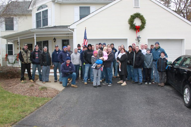 Officers from Toms River and Wall spent Saturday morning cleaning up the exterior of the Zane residence. (Photo courtesy of Wall Police Benevolent Association #234)