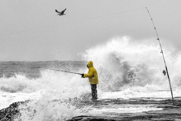A fisherman on an Asbury Park, N.J. jetty during a stormy day in early November. (Photo:  JSHN contributor Robert Raia)