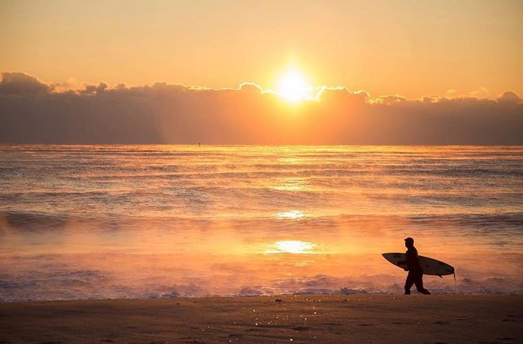 A surfer gazes at sea smoke over the northern Jersey Shore waters around sunrise yesterday. (Photo: Michael Guccione as tagged #JSHN on Instagram)