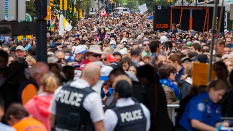 The security checkpoint at 18th and Cherry streets in Philadelphia was overrun on Sunday before Pope Francis' Mass on the Benjamin Franklin Parkway. (Brad Larrison/for NewsWorks)