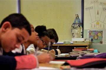 Students in Elaine Carboni's 8th grade class at Saint Gabriel School take a vocabulary test. (Emma Lee/WHYY)