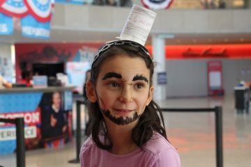 A yount Abraham Lincoln portrayer transforms her appearance with artful face paint during an Election Day visit to the National Constitution Center. (Emma Lee/WHYY)