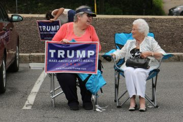 Women wait in the parking lot of the Springfield Mall in Delaware County, a stop for the  National Federation of Republican Women who are traveling the country encouraging Republican women to vote. (Emma Lee/WHYY)